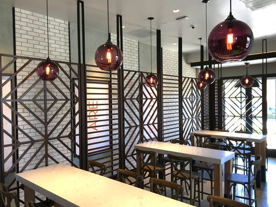 At Social Monk Asian Kitchen in Thousand Oaks, a geometric-screen wall  separates the dining area from the path to the order counter. The restaurant will open on Feb. 25.