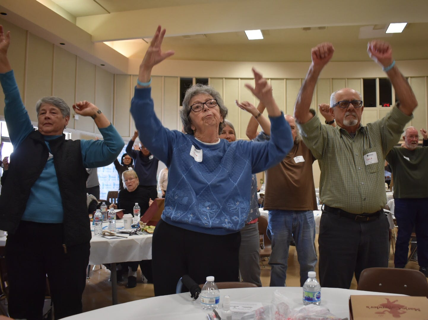 Laura Anter, middle, who has Parkinson's disease, exercises with her husband, David Anter, at a Camarillo conference on the disease.