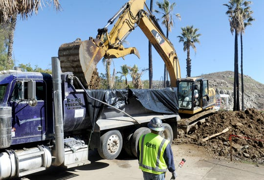 An excavator removes cement and soil material from 30 Appaloosa Lane in Bell Canyon, an unincorporated community on the eastern edge of Ventura County. State contractors are helping homeowners remove all the debris so they can start rebuilding.