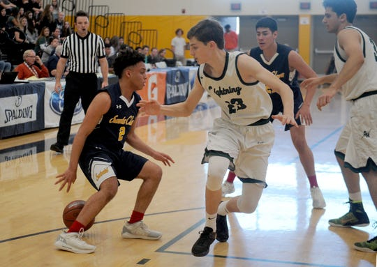 Santa Clara High's Chris Mack dribbles behind his back during the Saints' 68-52 victory over Sage Hill in the CIF-SS Division 5AA boys basketball final last season. Mack is one of the leaders for a rebuilding Santa Clara team this season.