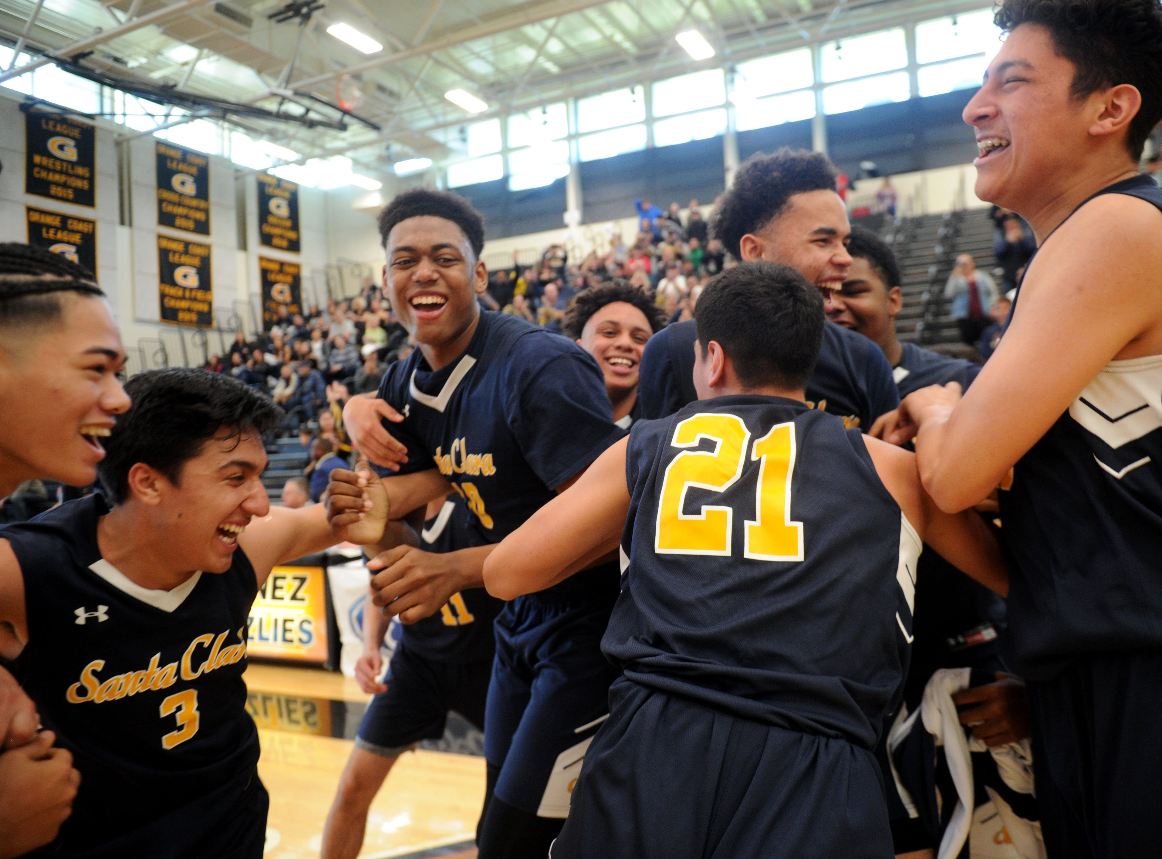 Santa Clara High players celebrate after defeating Sage Hill 68-52 in the CIF-Southern Section Division 5AA boys basketball championship game Saturday at Godinez High in Santa Ana.