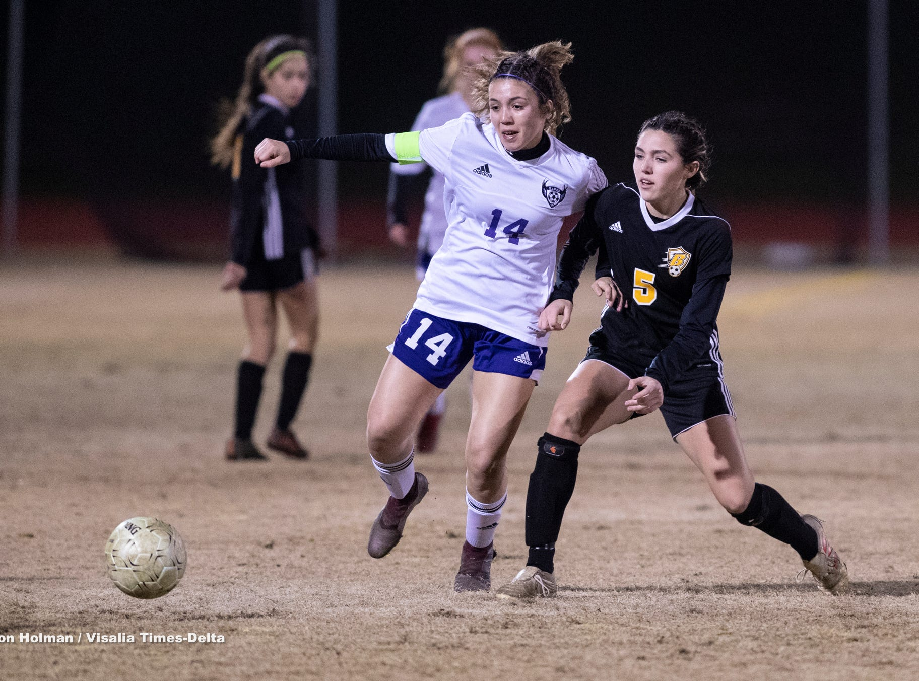 Mission Oak's Brianna Alvarez, left, battles with Golden West's Elizabeth Weldon in a Central Section Division III championship soccer game on Friday, February 22, 2019. Alvarez scored to give the Hawks the 1-0 win.