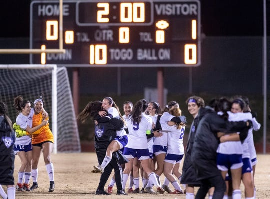 Mission Oak girls celebrate their win over Golden West in a Central Section Division III championship soccer game on Friday, February 22, 2019.