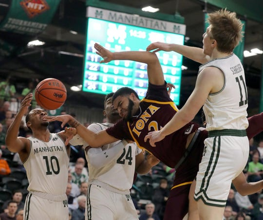 E.J. Crawford is pictured drawing a foul at Manhattan College on Feb. 22, 2019. Iona dropped its first game to the Jaspers since 2015 Sunday afternoon.