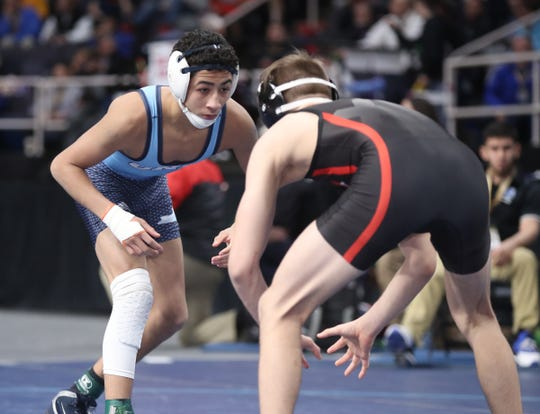 Port Chester's Ivan Garcia wrestles in the 120-pound match of the semifinal round of NYSPHSAA wrestling championship at The Times Union Center in Albany on Saturday, February 23, 2019.