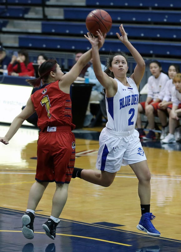 Haldane's Shianne Twoguns (2) puts up a shot in front of Keio's Akari Ishii (1) during playoff action at Pace University in Pleasantville Feb. 23,  2019. Haldane won the game 53-22.
