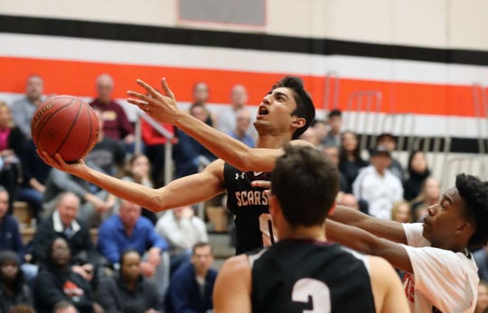 Scarsdale's Jayshen Saigal goes up for a shot over White Plains, during their Class AA quarterfinal at White Plains High School, Feb. 23, 2019. White Plains beat Scarsdale, 69-65 in overtime.