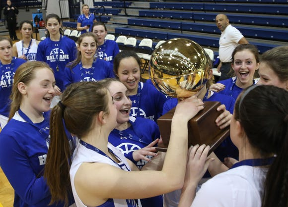 Haldane players celebrate with the gold ball after defeating Keio to win the Section 1 girls Class C championship at Pace University in Pleasantville Feb. 23,  2019.