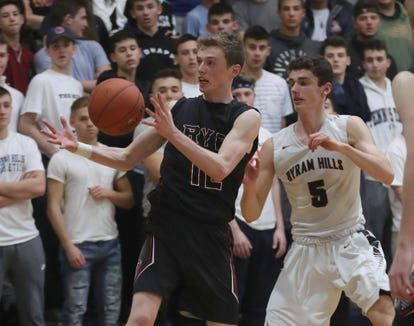 Ryan Lopp of Rye battles Sam Goldman of Byram Hills during a Section 1 Class A boys basketball quarterfinal basketball game at Byram Hills High School Feb. 23, 2019. Rye defeated Byram Hills 50-42.