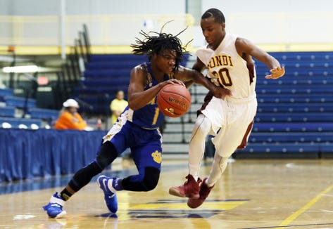MLK's Romello Fasion (1) drives to the basket against Biondi during the Section 1 Class D championship at Pace University in Pleasantville Feb. 22,  2019. Fasion finished with 39-points as MLK defeated Biondi 65-61 to win the Class D championship.