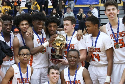 Tuckahoe players celebrate with the gold ball after defeating Hamilton to win the Section 1 Class C championship at Pace University in Pleasantville Feb. 23,  2019.