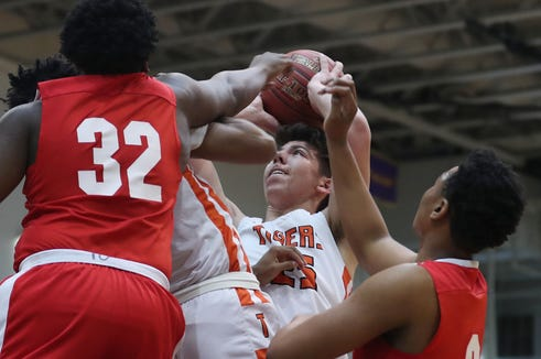 Tuckahoe's Jonathan Berger (25) gets fouled as he goes up for a shot against Hamilton during boys basketball playoff action at Pace University in Pleasantville Feb. 23, 2019. Tuckahoe won the game 59-45.