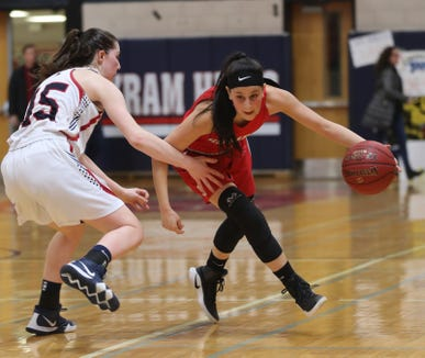 Dani DiCintio of Somers drives on Maggie Walsh of Byram Hills during the Section 1 Class A girls basketball quarterfinal at Byram Hills High School Feb. 23, 2019. Somers defeated Byram Hills 55-38.