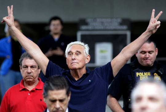 FILE - In this Jan. 25, 2019, file photo, former campaign adviser for President Donald Trump, Roger Stone walks out of the federal courthouse following a hearing in Fort Lauderdale, Fla. Stone was arrested Friday in the special counsel's Russia investigation and was charged with lying to Congress and obstructing the probe. (AP Photo/Lynne Sladky, File)