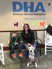 Rachael and son Marshall, 5, sit with terrier mix Sky after adopting her at the Delaware Humane Association in Wilmington on Friday, Feb. 22, 2019.