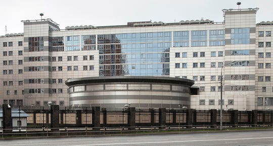 FILE - In this Saturday, July 14, 2018 file photo, a man walks past the building of the Main Directorate of the General Staff of the Armed Forces of Russia, also know as Russian military intelligence service in Moscow, Russia.  (AP Photo/Pavel Golovkin, File)