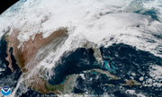 Widespread cloudiness over the entire eastern half of the country Saturday is associated with a developing powerful storm that will lead to rain Saturday night and Sunday and very strong winds by Monday in Delaware.