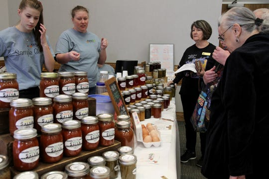 People browse Nana's Salsa and Cactus Jelly booth at the Arts Alive! Home and Garden Festival Saturday, Feb. 23, 2019, in the Ray Clymer Exhibit Hall.