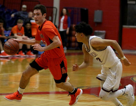 Burkburnett's Gavin Morris dribbles Friday, Feb. 22, 2019, in the Region I-4A area playoff against Brownwood in Graham. The Bulldogs defeated the Lions 87-68.