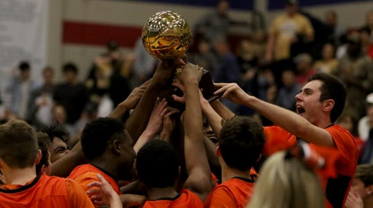 Burkburnett celebrates their Region I-4A area playoff win against Brownwood Friday, Feb. 22, 2019, in Graham. The Bulldogs defeated the Lions 87-68.