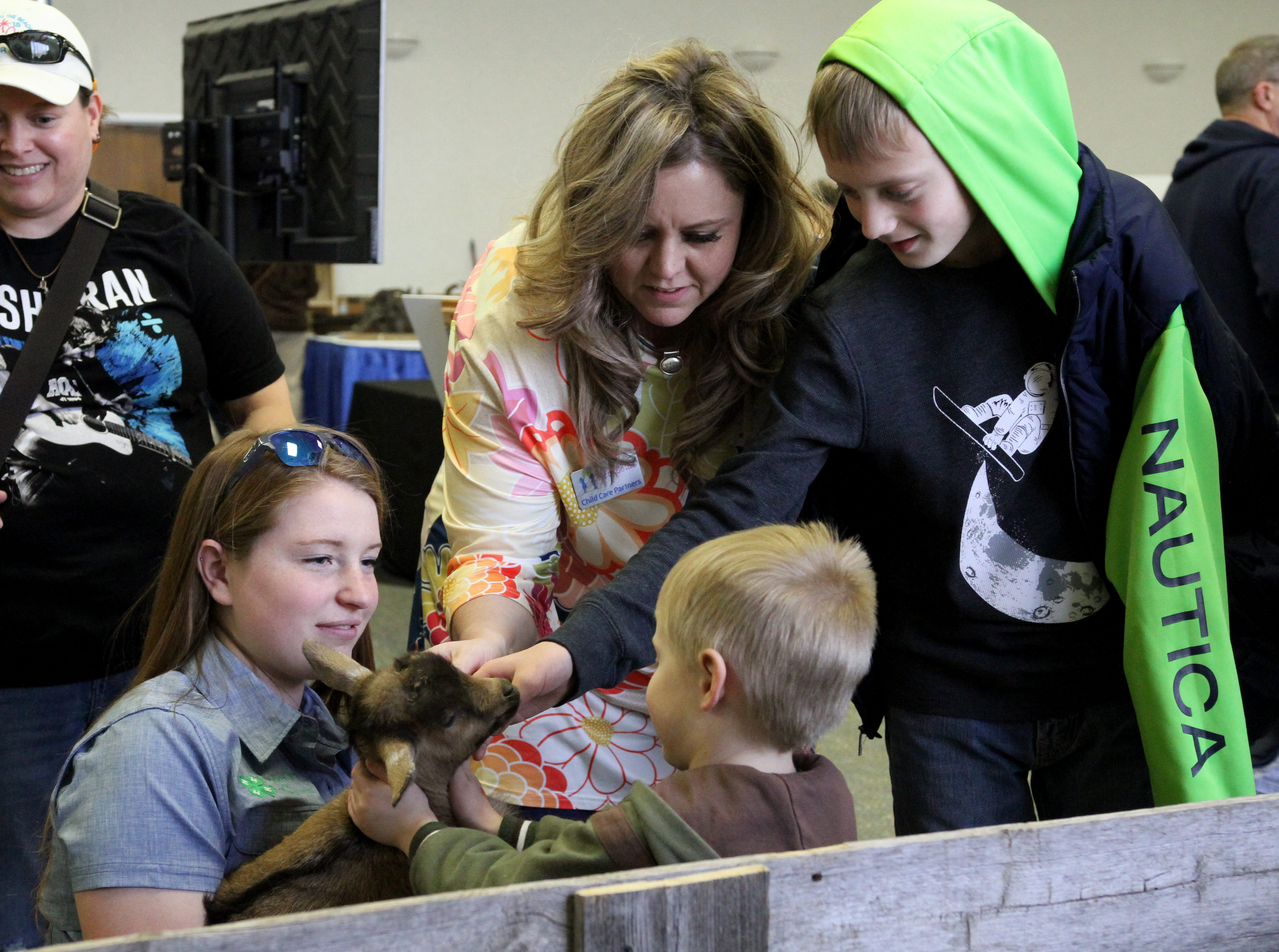 Ali Olsen, left, holds a baby goat as Keri Goins and her sons Gavin Ethan pet it at the Arts Alive! Home and Garden Festival Saturday, Feb. 23, 2019, in the Ray Clymer Exhibit Hall.