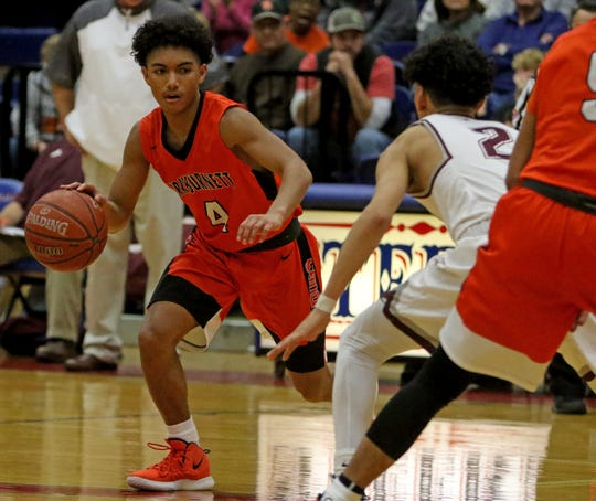 Burkburnett's Jaevion Moreland dribbles by Brownwood's Isyah Campos Friday, Feb. 22, 2019, in the Region I-4A area playoff in Graham. The Bulldogs defeated the Lions 87-68.