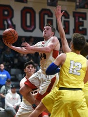 Weston Nern, of Rosecrans, goes flying through the lane during Rosecrans' 69-58 win against Maysville on Friday night at Rogge Gymnasium. Nern, a junior, scored a game-high 22 points with three assists as the Bishops wrapped up a 19-3 regular season.