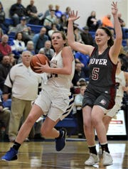 Maysville's Alexis Samson drives past Dover's Samantha Blair in Saturday's Division II sectional final. The Panthers won 75-67 in overtime.