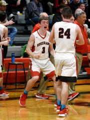 Rosecrans junior Paul Nern, left, is first to congratulate his twin brother, Weston, after the Bishops wrapped up a 69-58 win against Maysville on Friday night at Rogge Gymnasium. Weston Nern finished with a game-high 22 points as the Bishops wrapped up a 19-3 regular season.