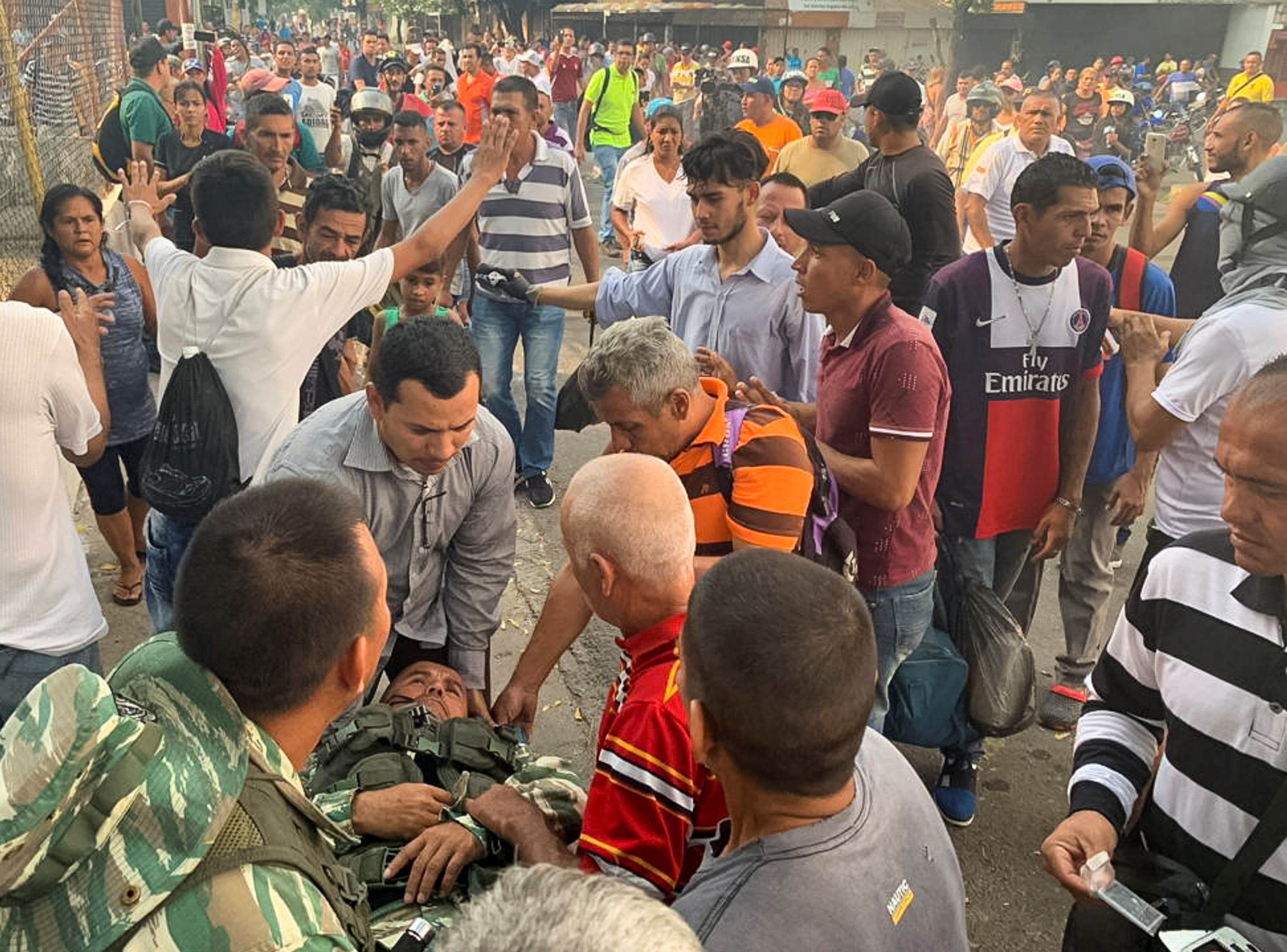 A sergeant (C) of the Venezuela Armed Forces militia is stretchered away after he was injured during clashes between the Bolivarian National Guard and demonstrators in the Venezuelan municipality of Urena, bordering Colombia, in Venezuela.