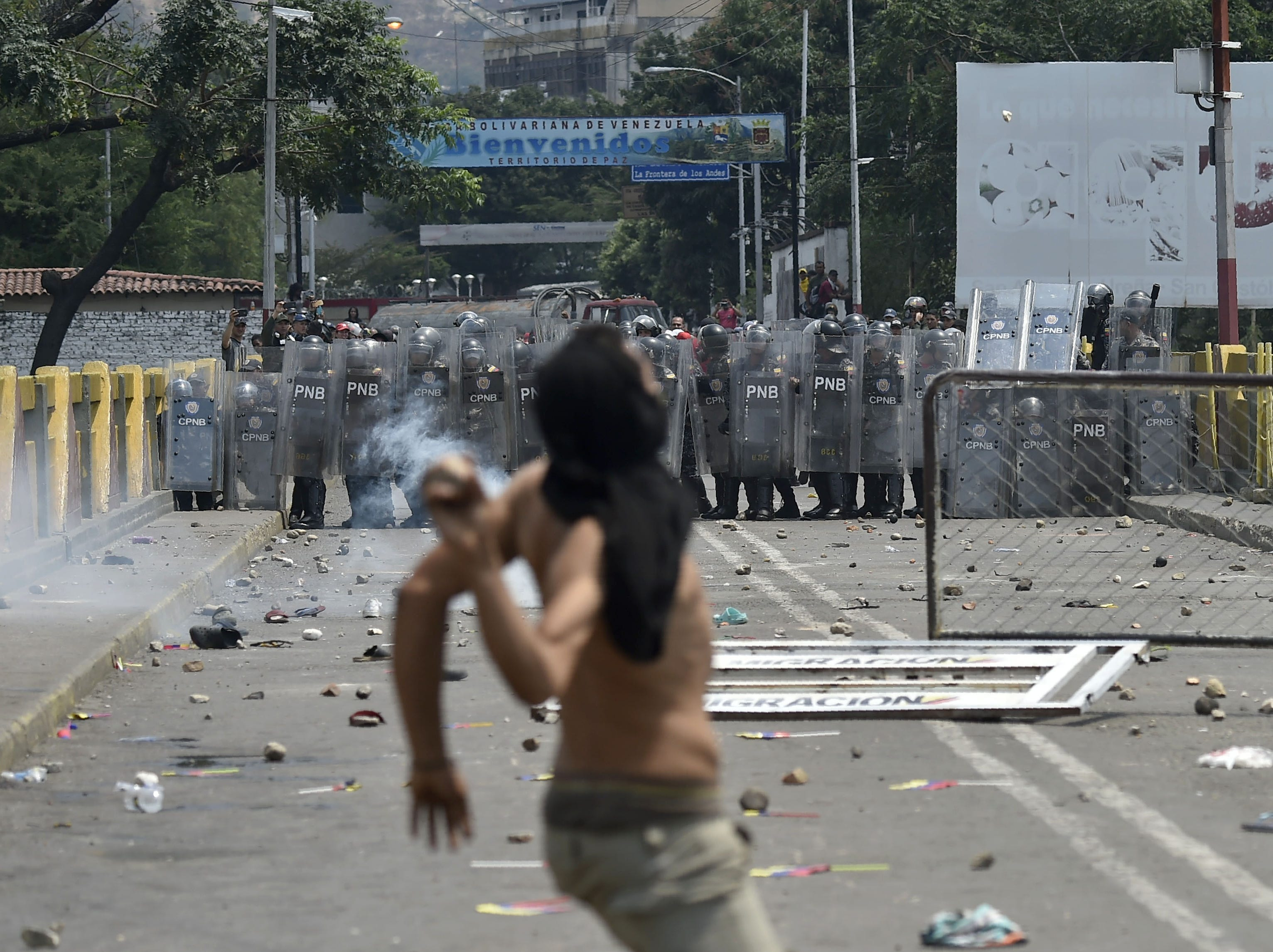 Demonstrators clash with Venezuelan national police at the Simon Bolivar bridge, in Cucuta, Colombia after President Nicolas Maduro's government ordered a temporary close-down of the border with Colombia on Feb. 23, 2019.
