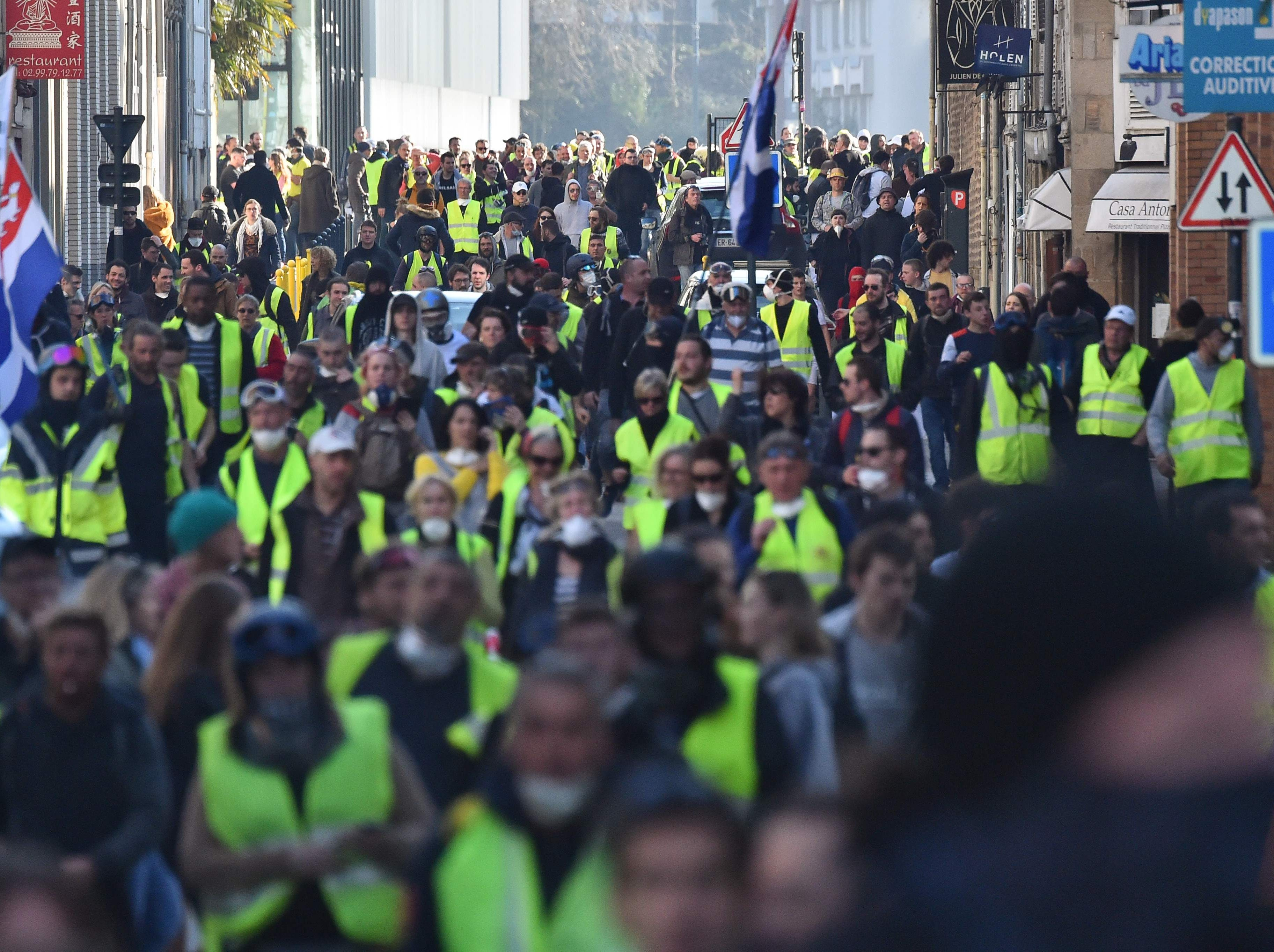 Members of the yellow vest (gilet jaune) take part in the 15th consecutive Saturday of demonstrations in Rennes, western France on Feb. 23, 2019.