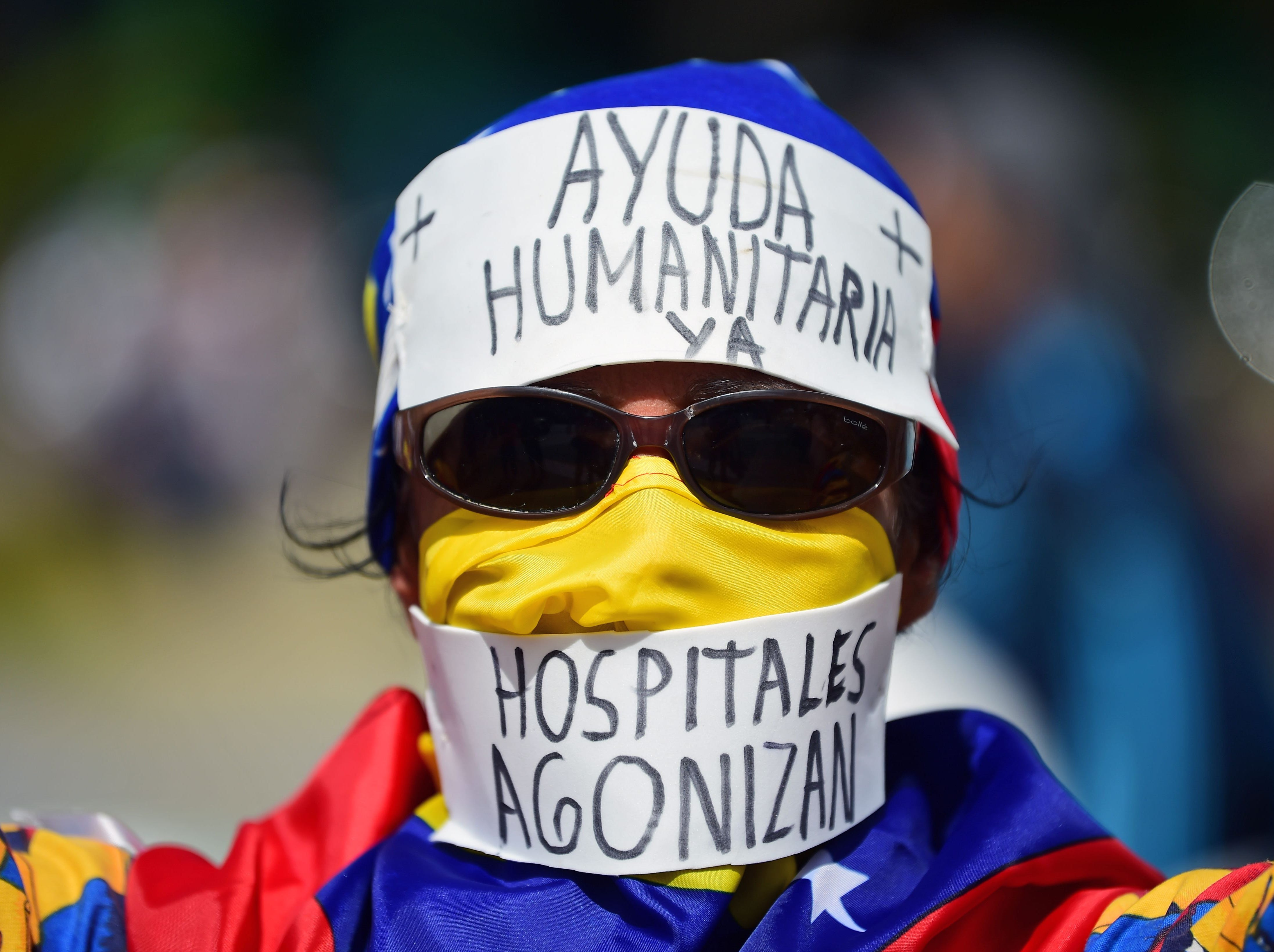 Supporters of Venezuelan opposition leader Juan Guaido wait to take part in a rally in Caracas, on Feb. 23, 2019.
