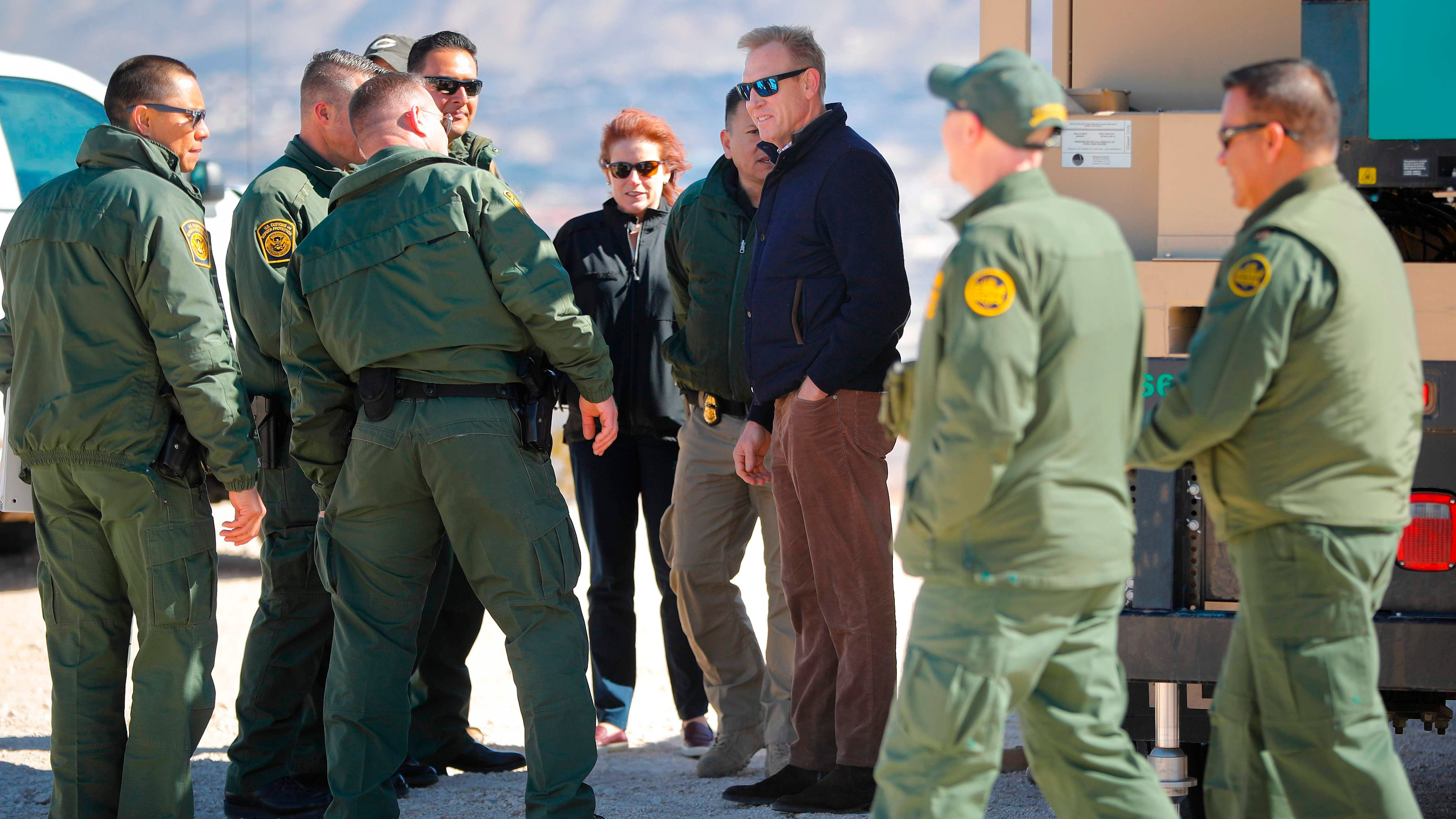 Acting US Secretary of Defense Patrick Shanahan (C) meets with Border Patrol Agents during a tour of the US-Mexico border at Santa Teresa Station in Sunland Park, New Mexico, Saturday, February 23, 2019.