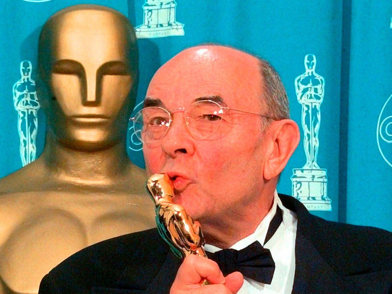 "In this March 23, 1998 file photo, director Stanley Donen kisses the Oscar he received for Lifetime Achievement backstage at the 70th Academy Awards at the Shrine Auditorium in Los Angeles. Donen, whose ""Singin' in the Rain"" provided some of the most unforgettable moments in movie history, has died, on Thursday, Feb. 21, 2019 in New York."