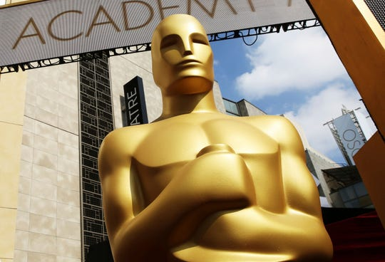 An Oscar statue appears outside the Dolby Theatre in Los Angeles.