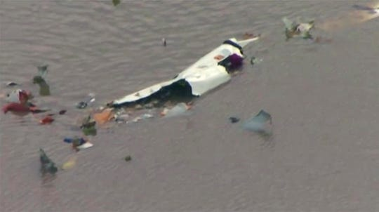 This image taken from video provided by KRIV FOX 26 shows the scene of a cargo plane crash on Feb. 23, 2019, in Trinity Bay, just north of Galveston Bay and the Gulf of Mexico in Texas.