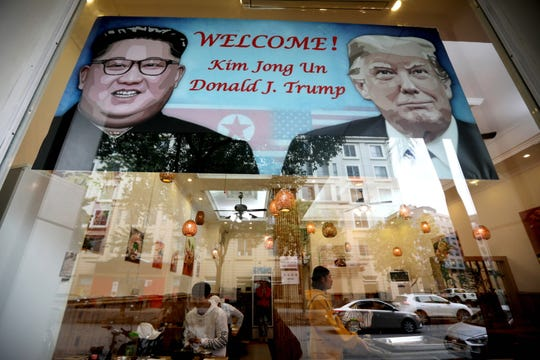 A poster featuring the upcoming second summit between the US and North Korea is seen at a restaurant in Hanoi, Vietnam, on Feb. 23, 2019.