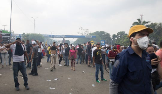 Tear gas hovers over the Simon Bolivar border crossing on February 23, 2019. Normally, 42,000 Venezuelans cross the border every day, but Maduro closed the bridge as opposition leaders tried to pass humanitarian aid.