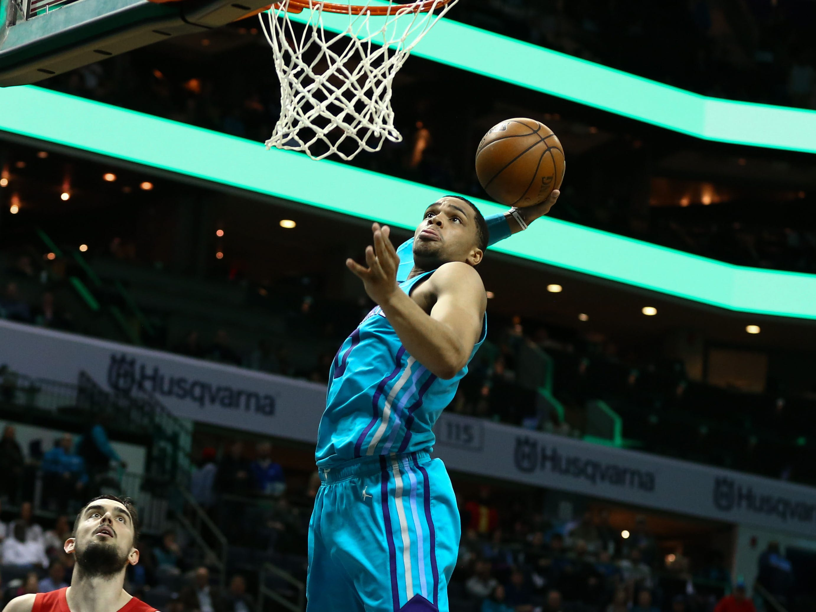 Feb. 22: Hornets forward Miles Bridges finishes strong with one hand against the Wizards.