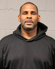 In this photo taken and released by the Chicago Police Dept., Friday, Feb. 22, 2019, R&B singer R. Kelly is photographed during booking at a police station in Chicago, Il. R. Kelly, the R&B star who has been trailed for decades by allegations that he violated underage girls and women and held some as virtual slaves, is due in court Saturday after being charged with aggravated sexual abuse involving four victims, including at least three between the ages of 13 and 17.