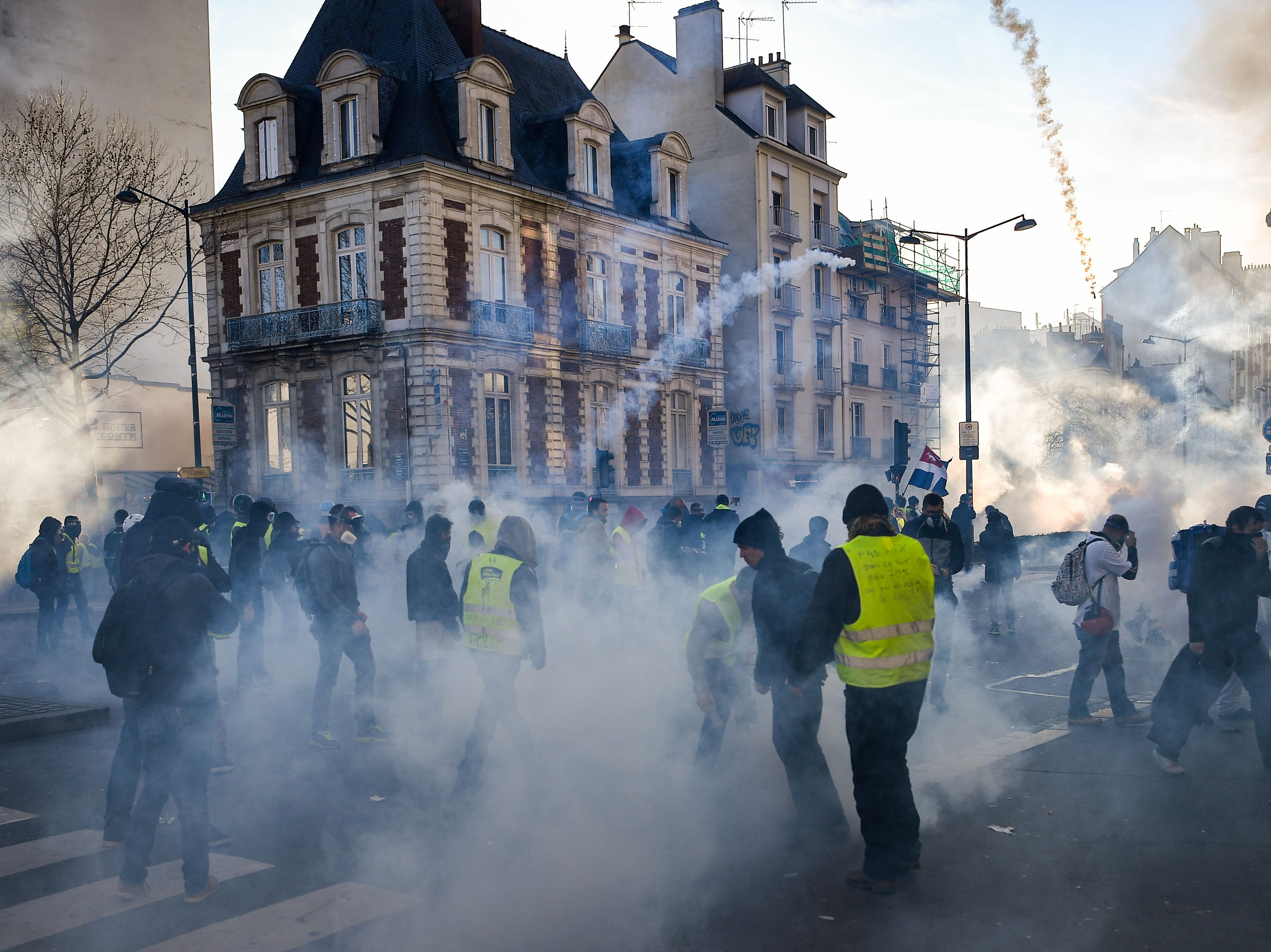 Police use tear gas as members of the yellow vest (gilet jaune) takes part in the 15th consecutive Saturday of demonstrations in Rennes, western France on Feb. 23, 2019.