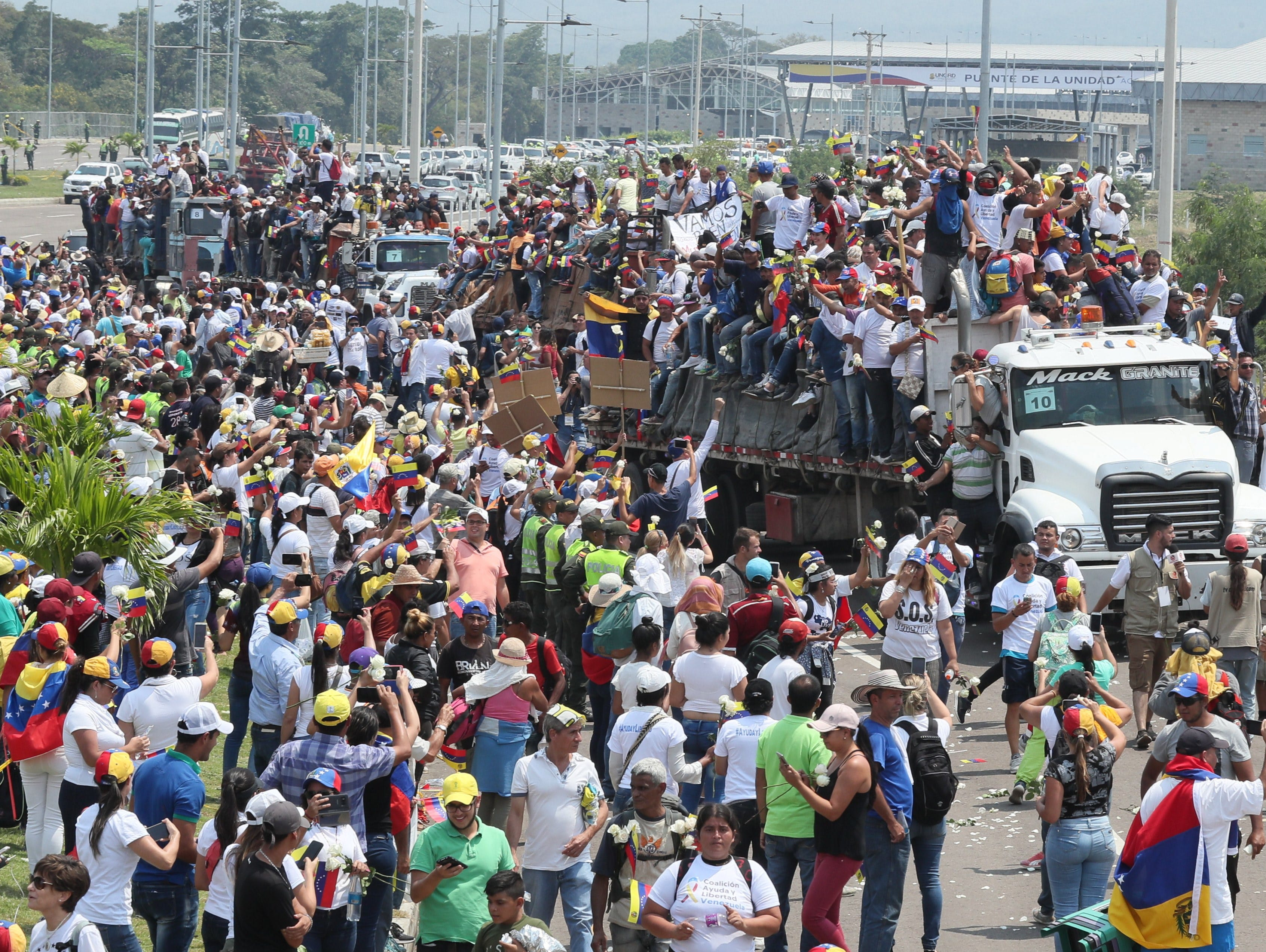 Venezuelan citizens riding in trucks, in Cucuta, Colombia on Feb. 23, 2019. Hundreds of Venezuelans gathered today on the Colombian side of the Simon Bolivar international bridge that connects Cucuta with San Antonio, in the Venezuelan state of Tachira, to form a corridor that allows humanitarian aid to go to their country.