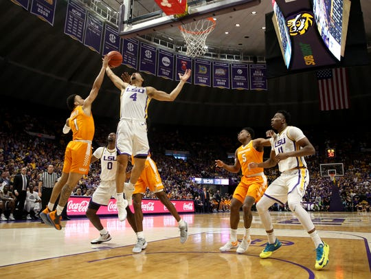 Tennessee Volunteers guard Lamonte Turner (1) and LSU Tigers guard Skylar Mays (4) fight for a rebound in the first half at the Maravich Assembly Center.