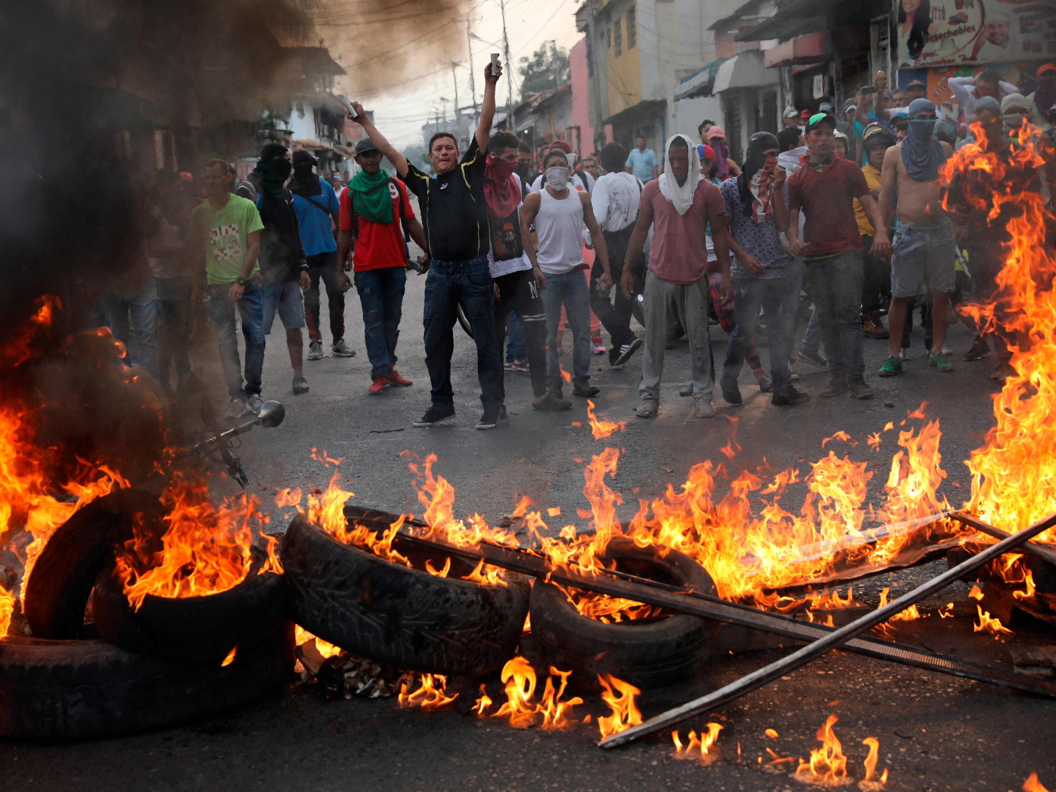 Demonstrators man a barricade during clashes with the Bolivarian National Guard in Urena, Venezuela, near the border with Colombia, Saturday, Feb. 23, 2019.