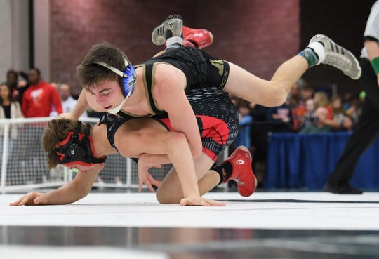Pendleton's Asa Addison defeats Gilbert's Barrett Crout 10-2 in the 120-pound weight weight class of the Class 3A state championship at the Civic Center of Anderson Saturday, February 23, 2019.