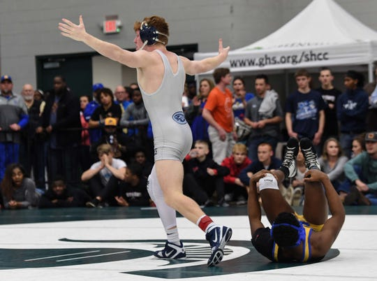 Eastside's Ben Maholtz defeated North Myrtle Beach's Jackie Gore with a pin in the 145-pound weight class of the Class 4A state championship at the Civic Center of Anderson Saturday, February 23, 2019.