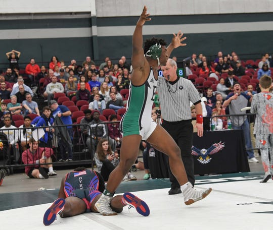 Easley's Josh Hill defeated Byrnes' Warren James with a pin in the 195-pound weight class of the Class 5A state championship at the Civic Center of Anderson Saturday, February 23, 2019.