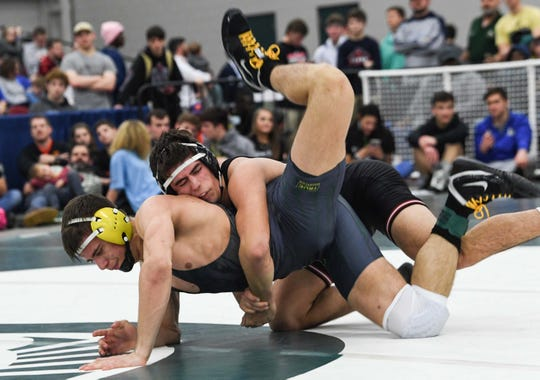 Hillcrest's Walker Stephenson defeated Conway's Christophe Handl in the 170-pound weight class of the Class 5A state championship at the Civic Center of Anderson Saturday, February 23, 2019.