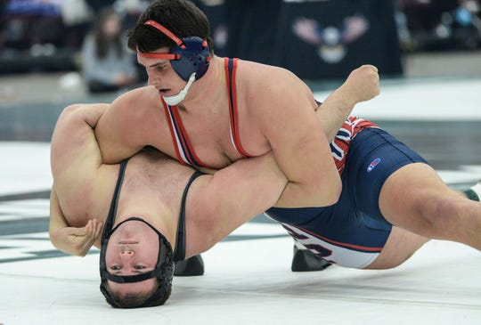 Belton-Honea Path senior Avery Reece defeated Hartsville's Jake James with a pin in the 285-pound weight class of the Class 4A state championship at the Civic Center of Anderson Saturday, February 23, 2019.